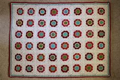 A Colorful Crochet Throw Hook up this cheery throw and add a little bit of modern retro flair to your favorite space! You will learn how to crochet an eight-petal flower, and add granny-style round…