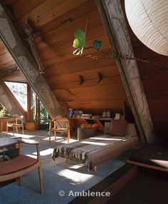 LOVE the wood and vaulted ceilings.  This must be in the woods somewhere.