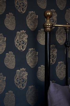 In this unique wallpaper is perfect for a feature wall in any room you love from the bedroom to the kitchen. Illustrated human hearts are replicated in gold line on a rich matt deep grey charcoal background.