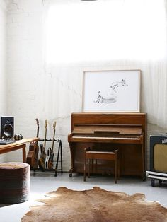 Love the balance in this studio and the cool guitar rack.