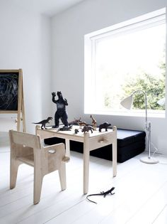The ultimate childrens furniture set - Peters Chair & Table, designed by Hans J Wegner in 1944. Here covered in monsters!