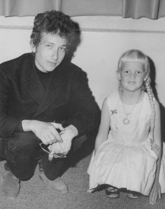 Here's a real rarity of a photo. Taken at Dylan's brother's high school graduation. The little girl's older sibling was in the same graduating class. Bob came back from New York to Hibbing, for the ceremony. He was already getting a name for himself in New York at the time so her mother asked Bob if he would pose for a photo with her daughter. It's an unpublished gem of a photo.