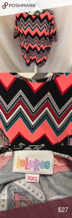 LULAROE IRMA Xxs LuLaRoe Irma in an amazing pink Chevron print 👚 if you're unfamiliar with this, it fits up to a size six comfortably!! 🎀 buttery soft legging material 💕 one of a kind ❌NO TRADES❌ ‼️make me an offer with the button below ‼️ BUNDLE WITH 2+ ITEMS AND GET 5% OFF 🎉 LuLaRoe Tops Blouses