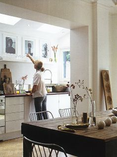 Shelves with art in kitchen