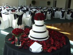 Beautiful cake table, black, white and red, wedding cake, cake table, reception, event decor. http://www.partyplannerdenver.com