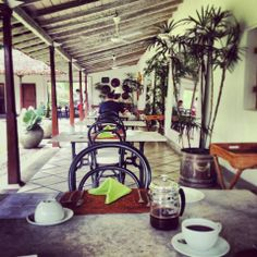 Morning coffee at The Kandy House, Kandy, Sri Lanka.   This beautiful outside restaurant area is an ideal spot for enjoying the gardens and wildlife at The Kandy House.   #HotelsinKandy #KandyHotels