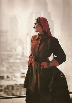 Lenore Simon in a coat by Roxspun and hat by Hattie Carnegie, photo by Louise Dahl-Wolfe for Harper's Bazaar Aug. 1944
