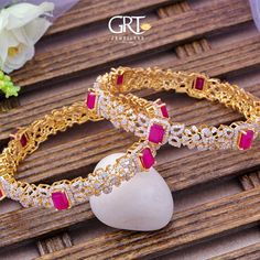 GRT Jewellers is one of the India's foremost jewellery store having an exquisite collection of jewellery in Gold, Diamond, Platinum and Silver created by the finest artisans of India. Also available exclusively in GRT Jewellers Online Jewellery Shopping. Ruby Bangles, Gold Bangles, Bridal Bangles, Designer Silver Jewellery, Gold Jewellery Design, Indian Jewelry Sets, Gold Jewelry Simple, Diamond Bangle, Diamond Jewellery