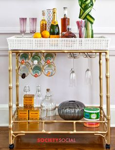 Bar Cart.  Love the hanging glasses and wine bottles.