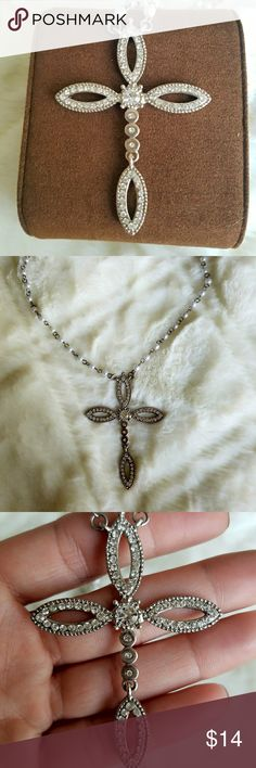 Beautiful crystal cross necklace Authentic Guess necklace with cross composed of crystals and chain has pearl like beads. Size is adjustable so you can have it hang lower. Extremely eye catching and lays beautifully 😍 Guess Jewelry Necklaces