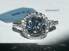 Gorgeous 4 carat ~ Swiss CZ Halo Ring SZ 5.75, 7.5,8.5. Starting at $5 on Tophatter.com!