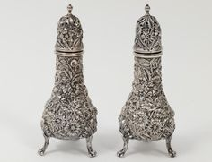 KIRK REPOUSSE STERLING SILVER SALT AND PEPPER SHAKER - Estimate: $100 - $150