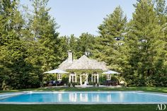 Ralph Lauren's Bedford, New York, poolhouse is surrounded by towering pines.