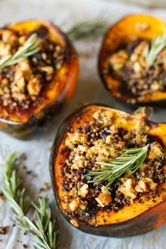 Stuffed Acorn Squash -- turn simple baked acorn squash into a meal by filling it with a tasty quinoa mixture, topped with an amazing rosemary pecan vinaigrette! | via @unsophisticook on http://unsophisticook.com