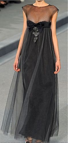 Chanel ... I think this would be a glamorous evenin' gown for the mama-to-be ...