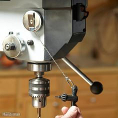 Drill Press Key Control - Mount a retracting key ring on your drill press and you'll never have to hunt for the chuck key again.