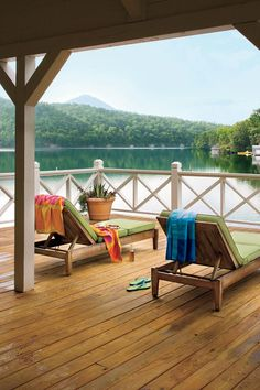 "Deck with a View - Lakeside Cabin Makeover - Southernliving. Lake Burton's water is clear and fresh, filled from the mountains above. ""The house sits at the end of the road, down a long, private lane,"" says Kathy, ""so our dogs can run around without getting into much trouble."""