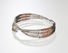 This bracelet is a part of the woven jewelry collection. Woven jewelry are representing the specific scale of our daily sentimentality, expressing them through the variety of forms and elements.
