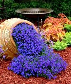 Outdoor Flower Planter Ideas | Tilted flower pot idea
