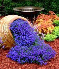 Outdoor Flower Planter Ideas | Tilted flower pot idea