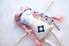 Orders placed after November 1st are not guaranteed delivery before the holiday.  We will try our hardest but if you are hoping to place your babe under the tree please email us first to check availability.  This little lady is a one-of-a-kind Sweet Little!Attention is paid to absolutely every detail from her head to her toes. She has a hand embroidered face and coral hair with two braids!  Her entire body is made of fabric that captures all the fun of the desert!  This litt...