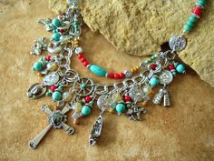 This Junk Gypsy statement necklace was created around a beautiful Hematite cross and seven, repurposed, vintage Southwest cowgirl charms. From the