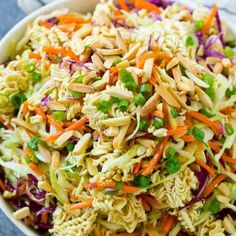 A bowl of ramen noodle salad with cabbage, noodles, green onions and almonds. A bowl of ramen noodle Ramen Noodle Cabbage Salad, Cabbage And Noodles, Cabbage Salad Recipes, Chicken And Cabbage, Broccoli Salad, Chicken Salad, Top Ramen Recipes, Asian Recipes, Noodle Recipes