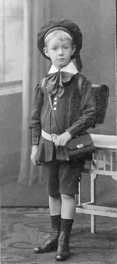 A Berlin school boy wearing a sailor cap and tunic to school, about 1905