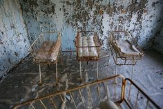 Baby cradles are seen in the nursery of a hospital in the abandoned town of Pripyat, in the exclusion zone around the Chernobyl nuclear power plant