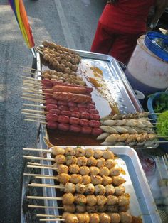 In Bangkok there are things on sticks. Fish balls, Isaan sausages and wieners.