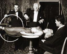 Having fun....floating a lady. Magician, Dick Zimmerman  Harry Blackstone, Sr.?