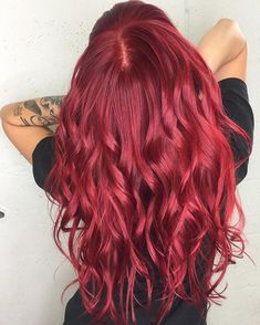 This bright vibrant true red Aveda hair color by Aveda artist Angel K. is a show-stopper.