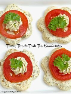 Tomato Pesto Sandwiches: Combine 1/4 cup plus 1 tbsp basil pesto with 8 oz cream cheese, softened. Spread onto bread. Top with sliced cherry tomato and fresh basil. Cut bread with cookie cutter after sandwich is assembled.