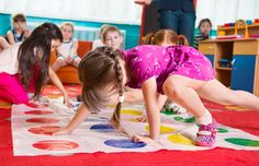 Twister is a fun game to work on bilateral coordination, body awareness, and gross motor skills! Copyright: <a href='https://www.123rf.com/profile_gosphotodesign'>gosphotodesign / 123RF Stock Photo</a>
