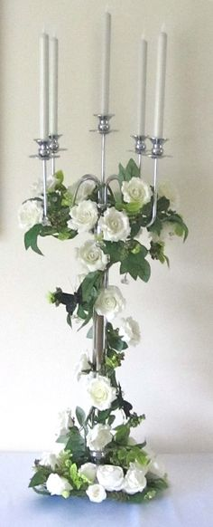 Ivory candelabra with wrapped greenery around centre and flowers in silk in colours scheme and draped amaranthus Rose Centerpieces, Elegant Centerpieces, Centrepieces, Wedding Table Centerpieces, Wedding Decorations, Garden Candles, Ivory Roses, Flower Garlands, Centerpieces