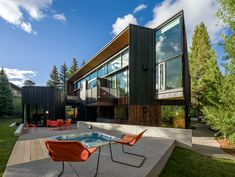 Will Bruder Architects designed a new home in Aspen, Colorado that features a space and backyard patio.