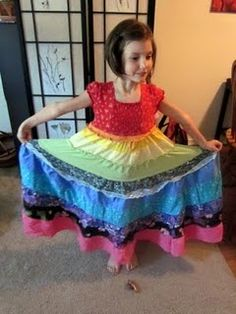 DIY rainbow dress from old clothes and fabric scraps. Looks like a great twirling dress for my girl!