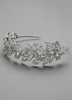 Sparkle and shine with this pointed open petal crystal headband!  Available in Silver.  Imported.