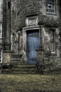 Nature is starting to reclaim this amazing main entrance of an abandoned castle in Scotland.  I adore the old blue door with the exquisite ornate hinges. Abandoned Castles, Abandoned Mansions, Abandoned Buildings, Old Buildings, Abandoned Places, Beautiful Buildings, Beautiful Places, Scottish Castles, Haunted Places