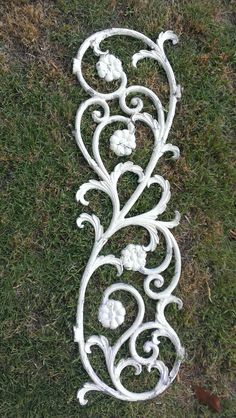 White chipped painted shabby antique daisey and scrolls cast metal panel offered for sale by OldHouseChic at Etsy on May 23rd.