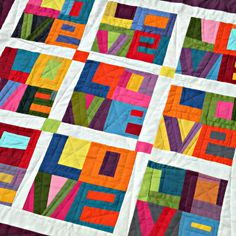 Picture of quilt from Quiltycat: Ta-dah! But use pattern and tutorial for paper piecing from  True Love ~ LOVE Mini-Quilt Pattern + Tutorial   Sew Mama Sew - Great tutorial and free download of letters (paper piecing) at http://www.sewmamasew.com/2012/02/true-love-love-mini-quilt-pattern-tutorial/
