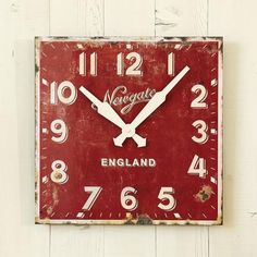 """Unabashedly red-faced as time goes by, our grand-scale wall clock pays retro-modern homage to a vintage English design. Painted wood composite with metal hands and quartz movement. Takes 1 AA battery (not included). 19-3/4"""" SQ."""