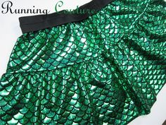 New Ariel inspired green fish scale print shimmery Running Misses two tier skirt, available in magenta, royal, silver and gold by RunningCouture on Etsy https://www.etsy.com/listing/265347166/new-ariel-inspired-green-fish-scale
