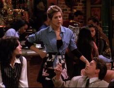 Rachel Green from Friends wearing a Short Chambray Shirt & High Waisted Skirt. Click here to find out more: http://withlovefromlou.co.uk/2016/08/rachel-green-friends/