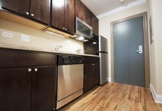Have plenty of storage in the kitchen with these beautiful cherry cabinets. #bjbproperties #chicagoapartments #lakeviewapartments