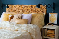 The crafty headboard in this Idaho bedroom adds some color and works well with the warm-toned sheets and pillowcases.