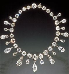The Napoleon necklace was a gift from Emperor Napoleon I to his second wife, Marie-Louise in 1811.  It  consists of 234 diamonds: 28 oval and cushion-cut diamonds, suspending a fringe of 19 briolette-cut oval and pear shaped diamonds and accented by small, round diamonds and diamond set motifs.