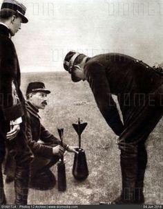 World War I. King Albert I of Belgium examining a bomb mechanism (1915) - stock photo