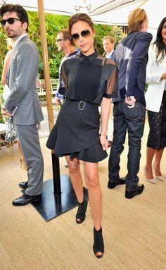 Pin for Later: 29 Times Victoria Beckham Completely Crushed It in Her Own Designs Victoria Wearing Her Spring 2014 Collection Victoria styled her top with an asymmetrical skater skirt instead of the board shorts it debuted with.