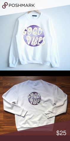 Good Vibes Graphic Sweatshirt ??ITEM IS NOT FROM LISTED BRAND! BRAND LISTED FOR EXPOSURE ONLY??  Good Vibes Sweatshirt Bright White No stains, tears, rips or holes Excellent Condition    Tags: Zara, Missguided, Urban Outfitters, Brandy Melville, Nasty Gal, Topshop, Pac Sun, Free People, American Eagle, Hollister, Sweatshirt, Graphic Tees, Floral Print Urban Outfitters Sweaters Crew & Scoop Necks